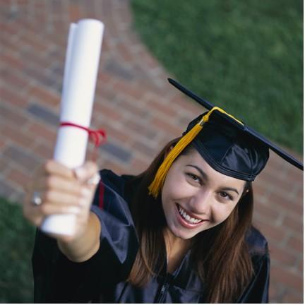 Grad girl with diploma